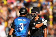 Ross Taylor of New Zealand congratulates team mate Grant Elliott after scoring 50 runs during the 2015 ICC Cricket World Cup final match between Australia and New Zealand at Melbourne Cricket Ground on March 29, 2015 in Melbourne, Australia.