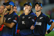 Grant Elliott, Martin Guptill and Matt Henry of New Zealand look dejected after defeat during the 2015 ICC Cricket World Cup final match between Australia and New Zealand at Melbourne Cricket Ground on March 29, 2015 in Melbourne, Australia.