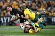 Liam Squire of the All Blacks is tackled by David Pocock and Bernard Foley of the Wallabies during The Rugby Championship Bledisloe Cup match between the Australian Wallabies and the New Zealand All Blacks at ANZ Stadium on August 18, 2018 in Sydney, Australia.