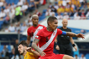 Mathew Leckie of Australia is challenged by Paolo Guerrero of Peru during the 2018 FIFA World Cup Russia group C match between Australia and Peru at Fisht Stadium on June 26, 2018 in Sochi, Russia.