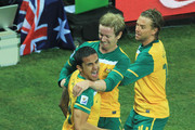 Tim Cahill of Australia (C) celebrates scoring the opening goal with team mates David Carney and Brett Holman (R) during the 2010 FIFA World Cup South Africa Group D match between Australia and Serbia at Mbombela Stadium on June 23, 2010 in Nelspruit, South Africa.