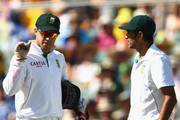 AB De Villiers and Imran Tahir of South Africa discuss  bowling plans during day three of the Second Test Match between Australia and South Africa at Adelaide Oval on November 24, 2012 in Adelaide, Australia.