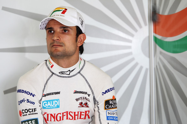 Vitantonio Liuzzi of Italy and Force India is seen in his team garage as he prepares to drive during practice for the Australian Formula One Grand Prix at the Albert Park Circuit on March 26, 2010 in Melbourne, Australia.