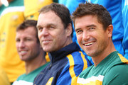 Harry Kewell, coach Holger Osieck and captain Lucas Neill look on during an Australian Socceroos team photo session at the Marriott Hotel on January 17, 2011 in Doha, Qatar.