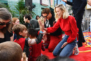 (L-R) Paul Rudd, Scarlett Johansson, Robert Downey Jr. and Brie Larson attend Avengers Universe Unites, a charity event to celebrate the donation of more than $5 million in cash and toys to nonprofits supporting children with critical illnesses, at Disney California Adventure Park on April 5, 2019 in Anaheim, California.