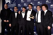 Guillermo Arriaga, Rodolfo Cova, Luis Silva, Director Lorenzo Vigas, Alfredo Castro and Michel Franco pose with the Golden Lion Award for Best Film for his movie 'From Afar' as he attends the award winners photocall during the 72nd Venice Film Festival on September 12, 2015 in Venice, Italy.