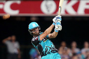 Brisbane player Alex Ross hits the ball during the Big Bash League match between the Brisbane Heat and the Melbourne Stars at The Gabba on December 20, 2017 in Brisbane, Australia.