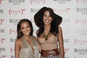Singer/actress Adrienne Bailon(L) and actress Julissa Bermudez   arrive at the (BELVEDERE) RED launches with Usher on February 10, 2011 in Hollywood, California.