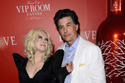 Singer Cyndi Lauper and David Thornton arrive at The (BELVEDERE)RED Party in Cannes featuring Cyndi Lauper at VIP Rooms at The JW Marriott on May 18, 2012 in Cannes, France.  (Photo by Ian Gavan/Getty Images for (BELVEDERE)RED)