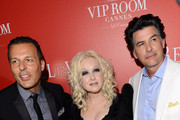 (L-R) VIP Room's Jean Roch, singer Cyndi Lauper and David Thornton arrive at The (BELVEDERE)RED Party in Cannes featuring Cyndi Lauper at VIP Rooms at The JW Marriott on May 18, 2012 in Cannes, France.  (Photo by Ian Gavan/Getty Images for (BELVEDERE)RED)