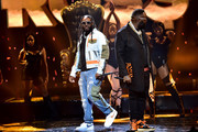 T-Pain and Rick Ross perform onstage at the BET Hip Hop Awards 2019 at Cobb Energy Center on October 05, 2019 in Atlanta, Georgia.
