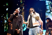 Rick Ross and T-Pain perform onstage at the BET Hip Hop Awards 2019 at Cobb Energy Center on October 05, 2019 in Atlanta, Georgia.