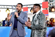 Laz Alonso (L) and Raheem Devaughn speak onstage during the Pre Show of the 2018 Soul Train Awards, presented by BET, on November 17, 2018 in Las Vegas, Nevada.