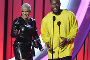 Keyshia Cole (L) and Tank present award onstage during the 2019 Soul Train Awards presented by BET at the Orleans Arena on November 17, 2019 in Las Vegas, Nevada.