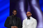 (L-R) Winston Duke and Dave Bautista speaks onstage during the 51st NAACP Image Awards, Presented by BET, at Pasadena Civic Auditorium on February 22, 2020 in Pasadena, California.