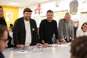 BFC launch fashion studio apprenticeship with ambassadorial president, David Beckham (c) and designers including Richard Quinn (l) at Prendergast Vale School on September 23, 2019 in London, England.