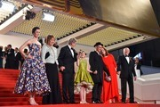 """(FromL) British actress Rebecca Hall, British actress Penelope Wilton, US director Steven Spielberg, US actress Ruby Barnhill, British actor Mark Rylance, US producer Kathleen Kennedy and US producer Frank Marshall pose outside the Festival Palace on May 14, 2016 after the screening of the film """"The BFG"""" at the 69th Cannes Film Festival in Cannes, southern France.  / AFP / LOIC VENANCE"""