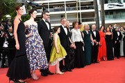 """(FromL) British screenwriter Lucy Dahl, British actress Rebecca Hall, New Zealander actor Jemaine Clement, US actress Ruby Barnhill, US director Steven Spielberg and his wife US actress Kate Capshaw, British actress Penelope Wilton, British actor Mark Rylance and his wife British composer Claire van Kampen, US producer Frank Marshall, US producer Kathleen Kennedy and US producer Kristie Macosko pose on May 14, 2016 as they arrive for the screening of the film """"The BFG"""" at the 69th Cannes Film Festival in Cannes, southern France.   / AFP / ALBERTO PIZZOLI"""