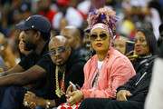 Rappers Jermaine Dupri and Da Brat sit courtside during week eight of the BIG3 three on three basketball league at Infinite Energy Arena on August 10, 2018 in Duluth, Georgia.