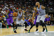 Ricky Davis #31 of the Ghost Ballers throws a pass to Carlos Boozer #5 against the 3 Headed Monsters during week eight of the BIG3 three on three basketball league at Infinite Energy Arena on August 10, 2018 in Duluth, Georgia.