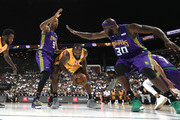 C.J. Leslie #5 of Bivouac handles the ball against Rashard Lewis #9 and Reggie Evans #30 of 3 Headed Monsters during week four of the BIG3 three-on-three basketball league at Barclays Center on July 14, 2019 in the Brooklyn borough of New York City.
