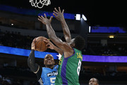 Cuttino Mobley #5 of the Power battles for the ball with Larry Sanders #8 of the 3 Headed Monsters during week nine of the BIG3 three on three basketball league at American Airlines Center on August 17, 2019 in Dallas, Texas.