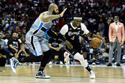 Derrick Byars #4 of the Enemies dribbles the ball while being guarded by Carlos Boozer #4 of the Power in the first half during week seven of the BIG3 three on three basketball league at Allstate Arena on August 03, 2019 in Chicago, Illinois.