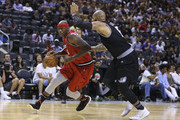 Al Harrington #3 of Trilogy drives against Carlos Boozer #5 of the Ghost Ballers during the BIG3 three on three basketball league at Scotiabank Arena on July 27, 2018 in Toronto, Canada.
