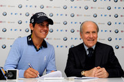 Matteo Manassero (L) of Italy signs documents as an Italian team member with Franco Chimenti, president of the Italian golf federation during a press conference prior to starting his professional career at the BMW Italian Open at Royal Park I Roveri on May 5, 2010 in Turin, Italy.