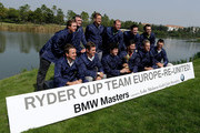 2012 Europe Ryder Cup members (back row) Nicolas Colsaerts of Belgium, Paul Lawrie of Scotland, Ian Poulter, Peter Hanson of Sweden; Justin Rose of England, Francesco Molinari of Italy- (front row) Graeme McDowell of Northern Ireland, Lee Westwood of England, Rory McIlroy of Northern Ireland, Jose Maria Olazabal of Spain, Luke Donald of England and Martin Kaymer of Germany pose with the Ryder Cup during the photocall and press conference prior to the start of the BMW Masters at the Lake Malaren Golf Club on October 23, 2012 in Shanghai, China.
