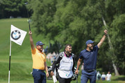 Tyrrell Hatton of England and Footballer Jamie Redknapp celebrate during the Pro Am for the BMW PGA Championship at Wentworth on May 23, 2018 in Virginia Water, England.