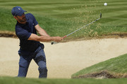 Jamie Redknapp plays out of a bunker during the Pro Am for the BMW PGA Championship at Wentworth on May 23, 2018 in Virginia Water, England.