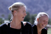 Maria Sharapova (L) of Russia and Caroline Wozniacki of Denmark share a laugh at a round table discussion during the BNP Paribas Open at the Indian Wells Tennis Garden on March 7, 2012 in Indian Wells, California.