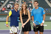 Daniela Hantuchova of Slovakia poses with Ryan Harrison plays Federico Delbonis of Argentina after performing the coing toss during the BNP Paribas Open at the Indian Wells Tennis Garden on March 8, 2018 in Indian Wells, California.