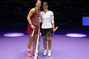 Kiki Bertens of the Netherlands and Angelique Kerber of Germany pose for a photo prior to the start of their singles match during day 2 of the BNP Paribas WTA Finals Singapore presented by SC Global at Singapore Sports Hub on October 22, 2018 in Singapore.