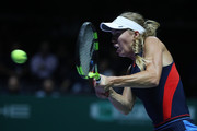 Caroline Wozniacki of Denmark plays a backhand in her singles match against Elina Svitolina of the Ukraine during day 5 of the BNP Paribas WTA Finals Singapore presented by SC Global at Singapore Sports Hub on October 25, 2018 in Singapore.