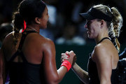 Naomi Osaka of Japan shakes hands with Angelique Kerber of Germany after their women's singles match during day 4 of the BNP Paribas WTA Finals Singapore presented by SC Global at Singapore Sports Hub on October 24, 2018 in Singapore.