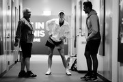 Image has been converted to black and white.) Caroline Wozniacki of Denmark warms up back stage with her coach Piortr Wozniacki during a prior to her singles match with Petra Kvitova of the Czech Republic prior to their singles match during day 3 of the BNP Paribas WTA Finals Singapore presented by SC Global at Singapore Sports Hub on October 23, 2018 in Singapore.  at Singapore Sports Hub on October 23, 2018 in Singapore.