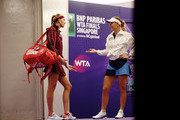 Caroline Wozniacki of Denmark reacts to walks onto the court prior to her singles match  with Petra Kvitova of the Czech Republic prior to their singles match during day 3 of the BNP Paribas WTA Finals Singapore presented by SC Global at Singapore Sports Hub on October 23, 2018 in Singapore.  at Singapore Sports Hub on October 23, 2018 in Singapore.
