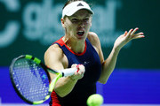 Caroline Wozniacki of Denmark plays a forehand in her singles match with Petra Kvitova of the Czech Republic prior to their singles match during day 3 of the BNP Paribas WTA Finals Singapore presented by SC Global at Singapore Sports Hub on October 23, 2018 in Singapore.