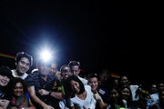 Angelique Kerber of Germany takes a selfie with fans after winning in her women's singles match against Naomi Osaka of Japan during day 4 of the BNP Paribas WTA Finals Singapore presented by SC Global at Singapore Sports Hub on October 24, 2018 in Singapore. at Singapore Sports Hub on October 24, 2018 in Singapore.