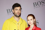 Daniel Preda and Madelaine Petsch attend the BOSS fashion show during the Milan Fashion Week Fall/Winter 2020 - 2021 on February 23, 2020 in Milan, Italy.