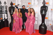 Perrie Edwards, Jesy Nelson, Jade Thirlwall and Leigh-Anne Pinnock of 'Little Mix' and Tom Walker in the winners room during The BRIT Awards 2019 held at The O2 Arena on February 20, 2019 in London, England.