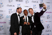 Gareth Southgate, Manager of England (L) and Dan Walker (R) pose for a photo with The Integrity and Impact Award founded by Dow Jones Intelligence winner, Raheem Sterling (C) at the BT Sport Industry Awards 2019 at Battersea Evolution on April 25, 2019 in London, England. The BT Sport Industry Awards is the biggest commercial sports awards in the world and an annual showcase of the best of the sector's creative and commercial output. The event brings together sports stars, celebrities, industry leaders, influencers and media from around the world for what is always a highly anticipated occasion.