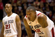 Billy White #32 and D.J. Gay #23 of the San Diego State Aztecs catch their breath during the second half against Brigham Young Cougars at Cox Arena on February 26, 2011 in San Diego, California. BYU beat SDSU 80-67.