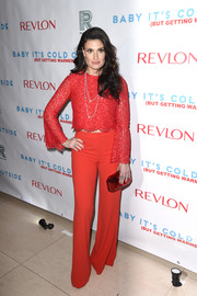 Idina Menzel went for easy elegance in a long-sleeve red lace crop-top at the 'Baby It's Cold Outside' concert.