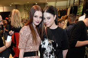 Actresses Lydia Hearst (L) and Michelle Trachtenberg attend the Balmain x H&M Los Angeles VIP Pre-Launch on November 4, 2015 in West Hollywood, California.