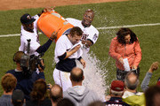 Aaron Hicks #32 and Torii Hunter #48 of the Minnesota Twins pour water on teammate Brian Dozier #2 and Fox Sports North reporter Marney Gellner after Dozier hit a two-run walk-off home run against the Baltimore Orioles in the tenth inning of the game on July 6, 2015 at Target Field in Minneapolis, Minnesota. The Twins defeated the Orioles 4-2 in ten innings.
