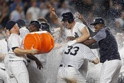 Matt Holliday #17 of the New York Yankees is congratulated by teammates after hitting the game winning 3-run home run against the Baltimore Orioles during the tenth inning at Yankee Stadium on April 28, 2017 in the Bronx borough of New York City. The Yankees won 14-11.