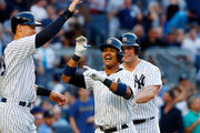 Starlin Castro #14 of the New York Yankees celebrates his second inning three run home run against the Baltimore Orioles with teammates Aaron Judge #99 and Matt Holliday #17 at Yankee Stadium on June 10, 2017 in the Bronx borough of New York City.
